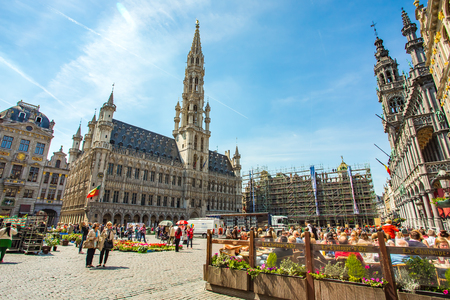 guildhalls: Brussels, Belgium - May 16, 2014: The Grand Place is the central square of Brussels. It is surrounded by opulent guildhalls and two larger edifices, the citys Town Hall. Editorial