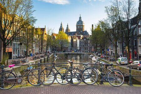 dutch canal house: Morning at Amsterdam canals city in Netherlands.