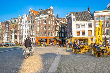 amstel: Amsterdam, Netherlands - April 13, 2016: Amsterdam is the largest city and capital of the Netherlands by the Amstel river. Editorial