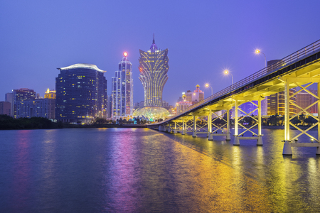 Building and the skyline of Macau city at night.