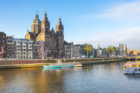 Amsterdam, Netherlands - April 13, 2016: The view of Amsterdam city with the canal in Netherlands. Éditoriale