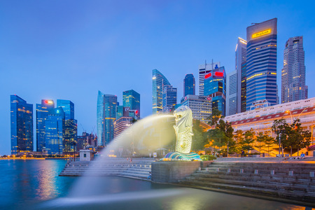 Singapore City, Singapore - July 18, 2015: The Merlion and buidlings in city center of Singapore.
