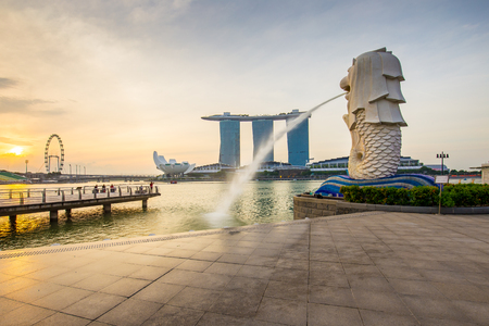 Singapore City, Singapore - July 18, 2015: The Merlion with sunrise in city center of Singapore.