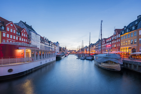Nyhavn Canal at night in Copenhagen city, Denmark.