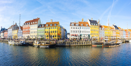 Copenhagen, Denmark - May 1, 2017: Nyhavn with its picturesque harbor with old sailing ships bobbing on the canals' water, and colorful facades of old houses Publikacyjne