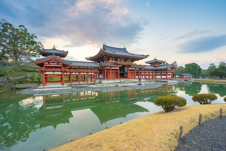 Kyoto, Japan - December 31, 2015: Byodo-in is a Buddhist temple in the city of Uji in Kyoto Prefecture, Japan. It is jointly a temple of the Jodo-shu (Pure Land) and Tendai-shu sects. Stock Photo