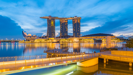 Singapore City, Singapore - 22 January, 2017: Singapore Marina Bay Sands and Merlion at night in Singapore city