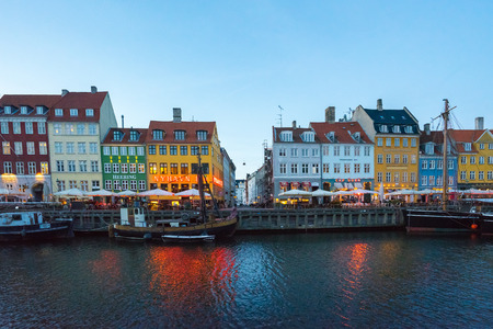 Copenhagen, Denmark - May 1, 2017: Nyhavn is a 17th-century waterfront, canal and entertainment district in Copenhagen, Denmark.