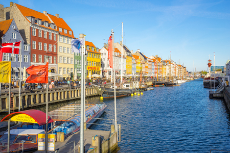 Copenhagen, Denmark - May 1, 2017: Nyhavn was originally a busy commercial port where ships from all over the world would dock. The area was packed with sailors, ladies of pleasure, pubs and alehouses. Éditoriale