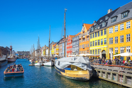 Copenhagen, Denmark - May 1, 2017: Nyhavn was originally a busy commercial port where ships from all over the world would dock. The area was packed with sailors, ladies of pleasure, pubs and alehouses. Editorial