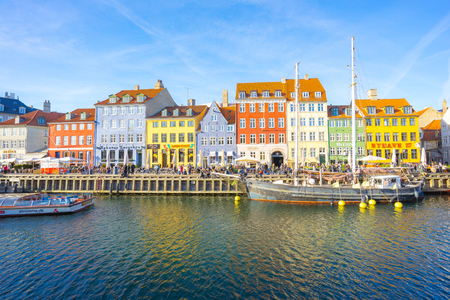 Copenhagen, Denmark - May 1, 2017: Nyhavn with its picturesque harbor with old sailing ships bobbing on the canalsÂ' water, and colorful facades of old houses Éditoriale