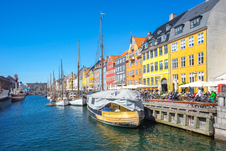 Copenhagen, Denmark - May 1, 2017: Nyhavn is a 17th-century waterfront, canal and entertainment district in Copenhagen, Denmark.
