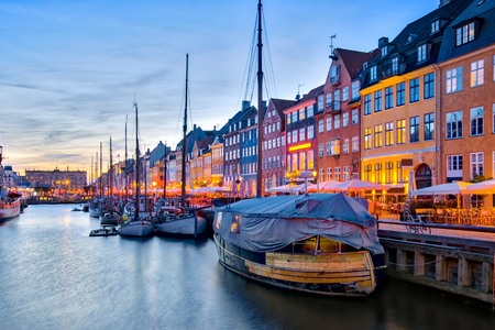 Nyhavn with its picturesque harbor with old sailing ships and colorful facades of old houses in Copenhagen, Denmark. Banque d'images