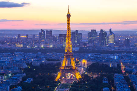 Paris, France - May 14, 2014: Night of Paris city skyline with Eiffel Tower. Éditoriale