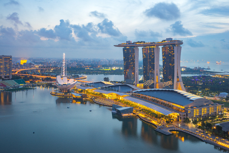 Singapore skyline and view of Singapore city at night with view of Marina Bay