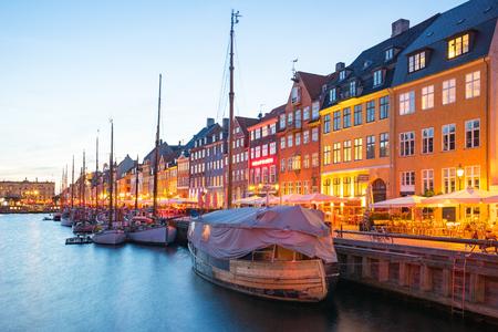 Copenhagen port city at night in Denmark.