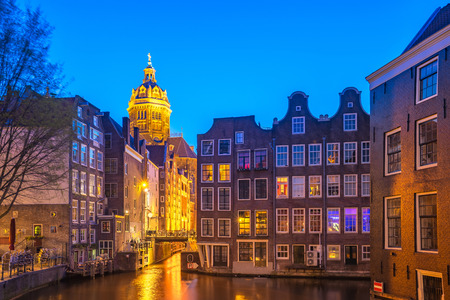 Amsterdam city at night in Netherlands.