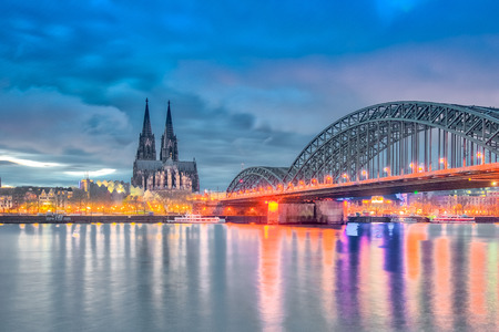 Dramatic skyline by Rhine River in Cologne, Germany.