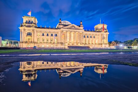 Night at the Reichstag building in Berlin, Germany (The dedication Dem deutschen Volke, meaning To the German people, can be seen on the frieze)