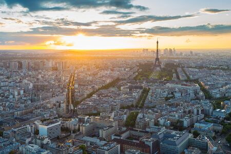 Eiffel Tower rooftop view with at sunset in Paris, France.