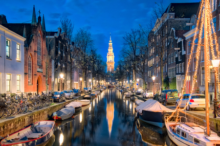 The canal in Amsterdam with Zuiderkerk church in Amsterdam city, Netherlands.