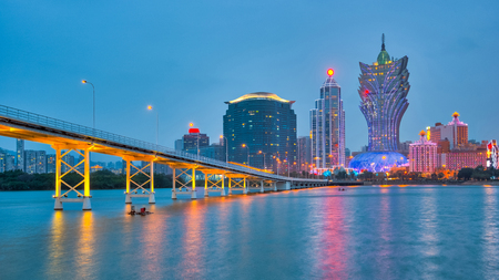 Panorama view of Macau cityscape at night in China.