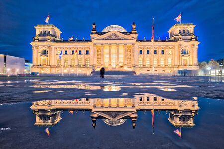 The Reichstag building at night in Berlin. (The dedication Dem deutschen Volke, meaning To the German people, can be seen on the frieze) Éditoriale