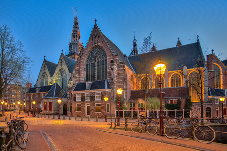 The old church Oude Kerk in Amsterdam city at night, Netherlands.