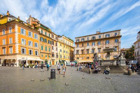 Rome, Italy - April 17, 2015: View of Fontana di S. Maria in Trastevere in Rome, Italy.
