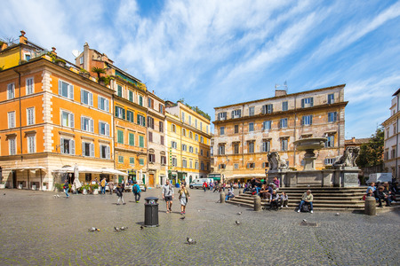 Rome, Italy - April 17, 2015: View of Fontana di S. Maria in Trastevere in Rome, Italy.