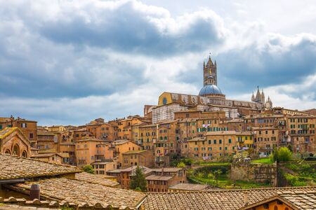 View of Siena city skyline with Duomo of Siena in Tuscany, Italy. Éditoriale