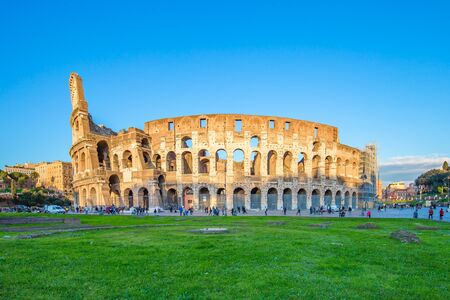 View of Colosseum and sunset in Rome, Italy.