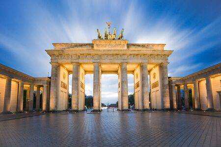 Dramatic sky with Brandenburg gate in Berlin city, Germany. Éditoriale