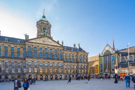 Amsterdam city, Netherlands - April 11, 2016: The Royal Palace with the tourist in Amsterdam city, Netherlands.