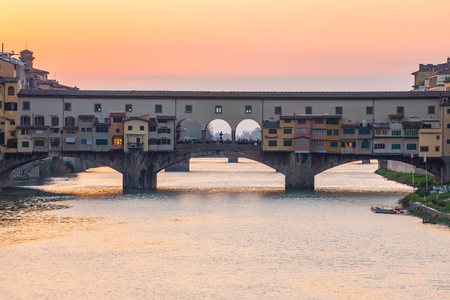 Sunset view at Ponte Vecchio bridge in Florence, Tuscany, Italy.