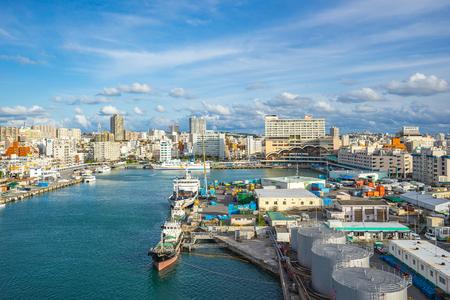 Tomari Port with Okinawa city skyline in Naha, Okinawa, Japan.