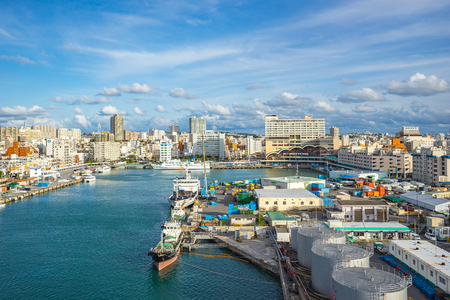 Tomari Port with Okinawa city skyline in Naha, Okinawa, Japan.