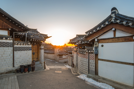 Sunrise in the morning with view of Bukchon Hanok Village in Seoul, Korea.