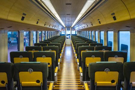 Fukuoka, Japan - February 9, 2018: Interior of Yufuin No Mori Limited express train in Fukuoka, Japan. Éditoriale