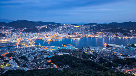 Panorama view of Nagasaki city skyline at night in Japan.