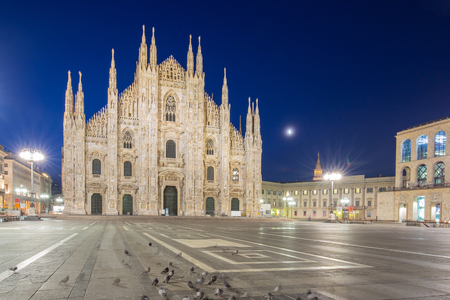 Milan Cathedral from the square at night in Milan, Italy.