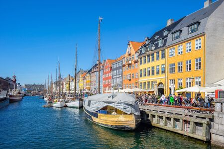 Copenhagen, Denmark - May 2, 2017: Colorful buildings of Nyhavn in Copenhagen city, Denmark.