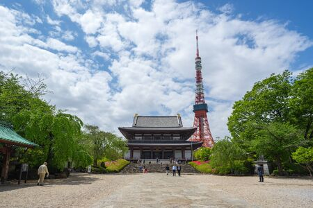 Tokyo Tower with Zojoji Temple in Tokyo city, Japan. Editorial