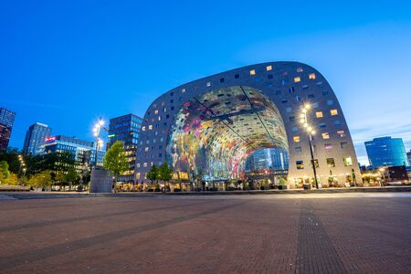 Rotterdam, Netherlands - May 13, 2019: Night view of Rotterdam skyline at night with Markthal the new market in Netherlands.
