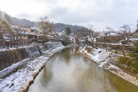 Takayama old town with snow falling in Gifu, Japan.