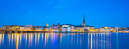 Stockholm cityscape skyline with view of Gamla Stan at night in Stockholm, Sweden.