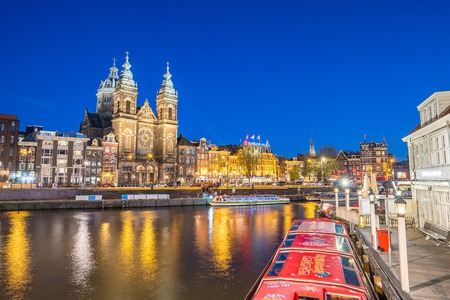 Amsterdam skyline with landmark buidings and canal in Amsterdam city, Netherlands. 新聞圖片