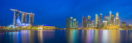Panorama view of Singapore bay and skyline at night.
