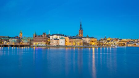 Stockholm city skyline with view of Gamla Stan at night in Stockholm, Sweden.
