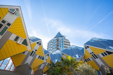 Rotterdam, Netherlands - May 13, 2019: Cube House with Rotterdam skyline in Rotterdam, Netherlands